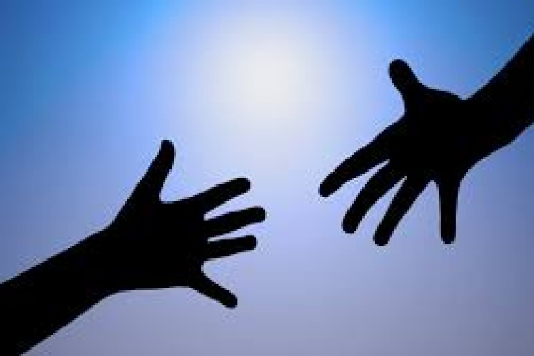 Hands Reaching Out Image